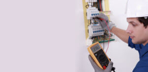 EICR testing by Glasgow electrician with testing meter