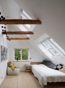 Loft conversion bedroom with exposed wooden beams and double bed