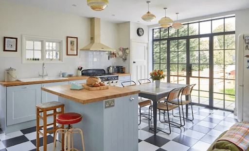 Small kitchen island in a farmhouse style kitchen with tiled floor