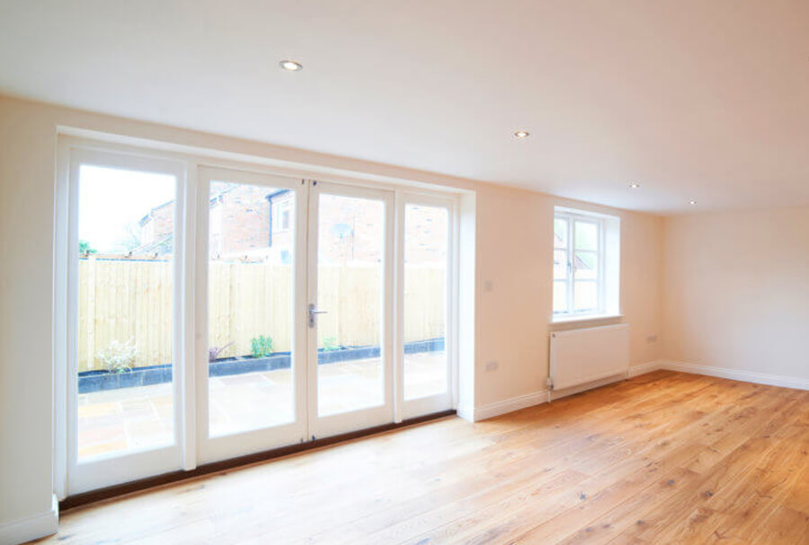 Large room with 4 double glazed doors and wooden floor in Glasgow