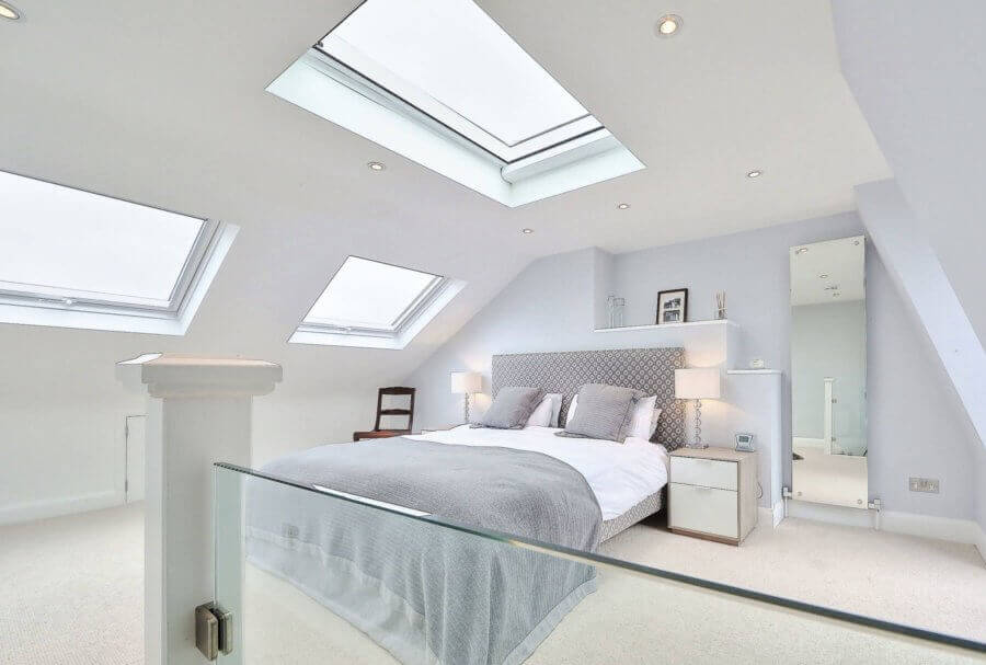 Bedroom loft conversion with glass balustrades and roof lights Glasgow