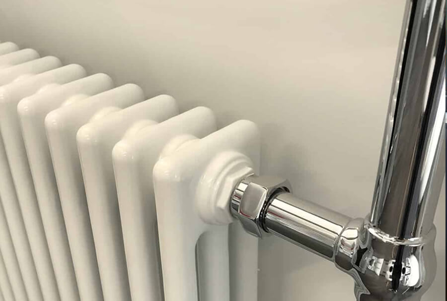 Old Victorian style central heating radiator with chrome pipes