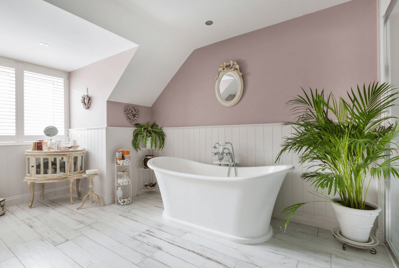 Pink bathroom with roll top bath