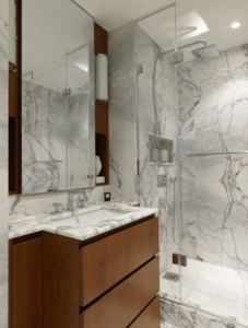 Marble walled shower room design and marble top sink