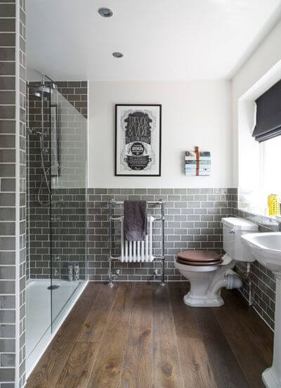 Victorian style bathroom with antique style bathroom suite and exposed floorboards