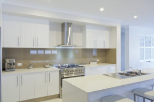 Kitchen renovation with white glossy cabinets